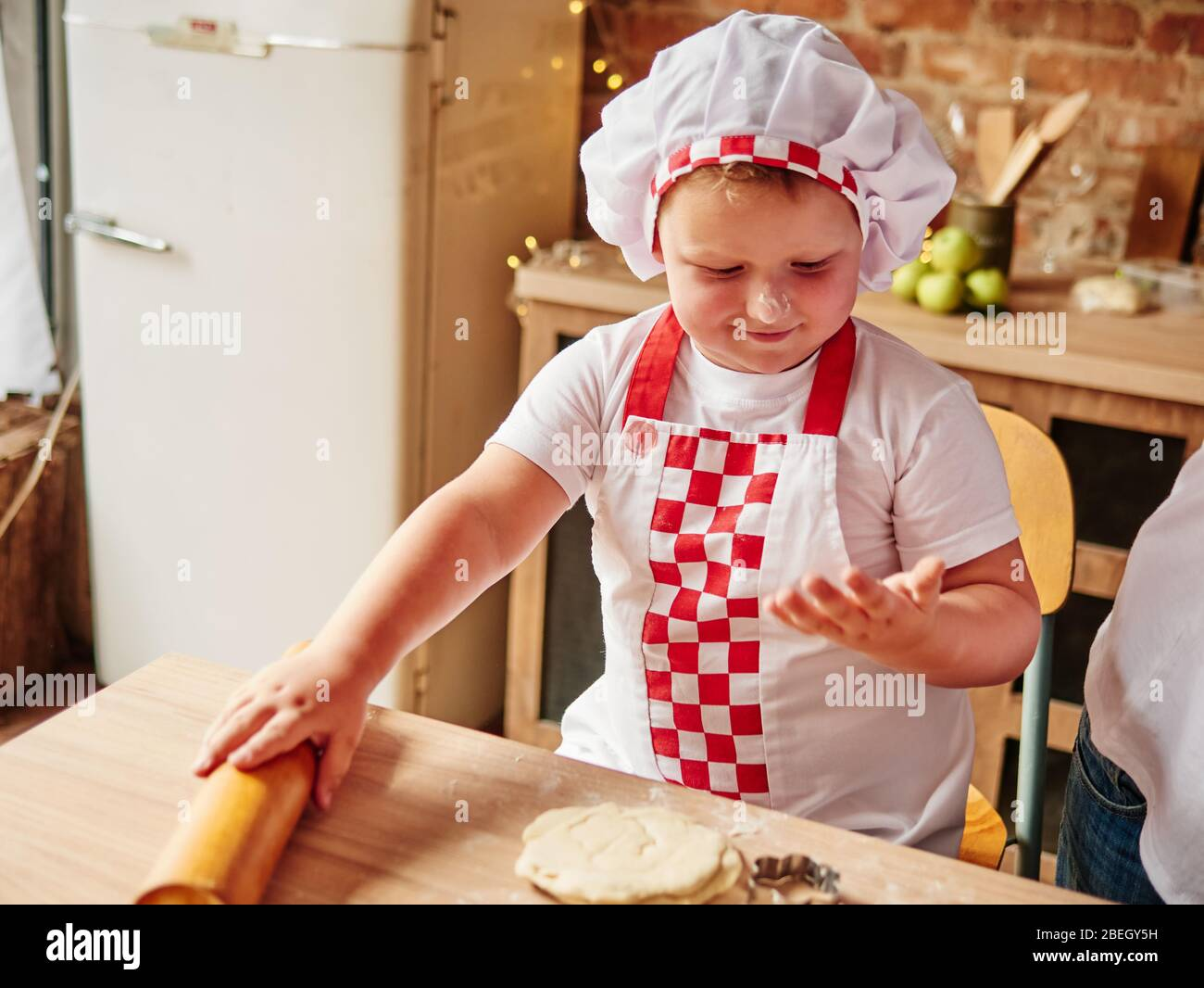 Little Boy Is Cooking In A Domestic Kitchen Happy Family Happy