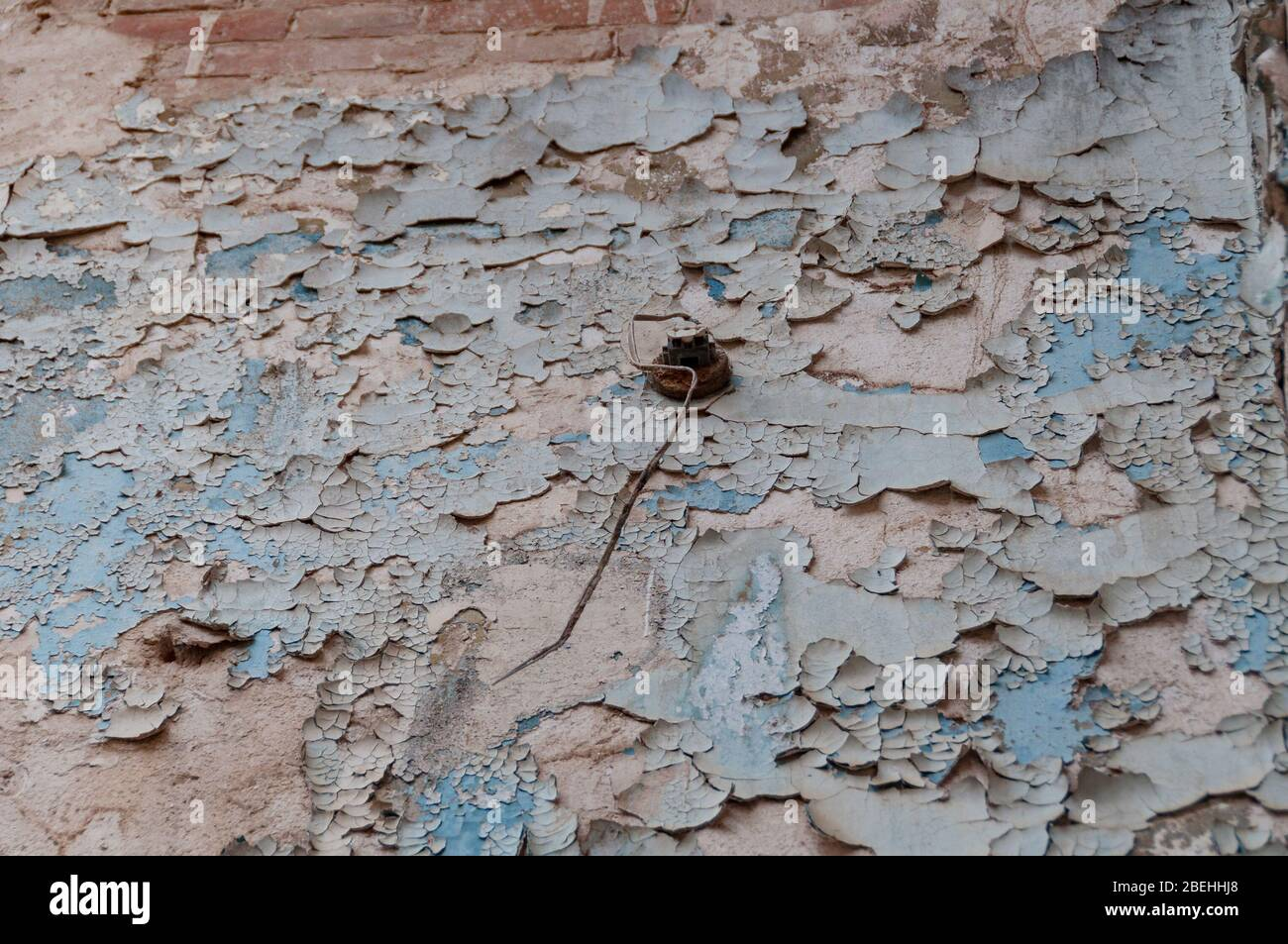 Close up of cracked paint, flacking off wall texture Stock Photo