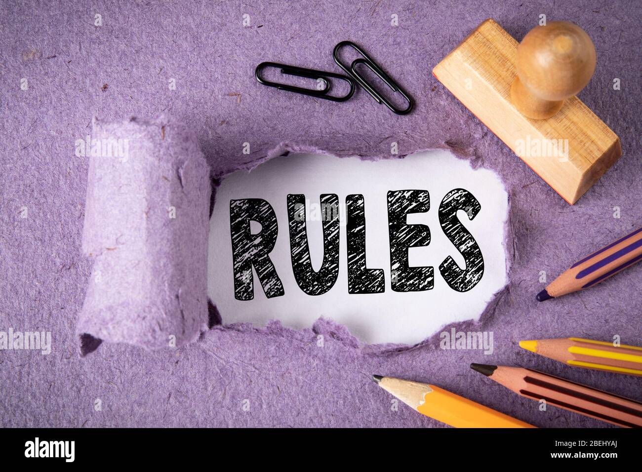 Rules. Audit, guidance, success and business concept. Text under torn paper Stock Photo