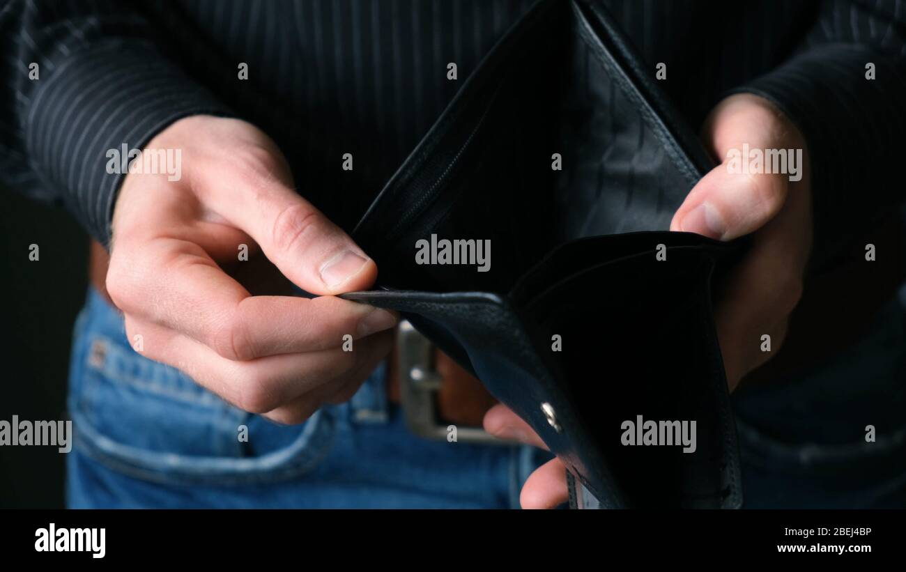Empty Wallet In Male Businessman Hands. Bankruptcy Concept, Financial Crisis, No Money Stock Photo