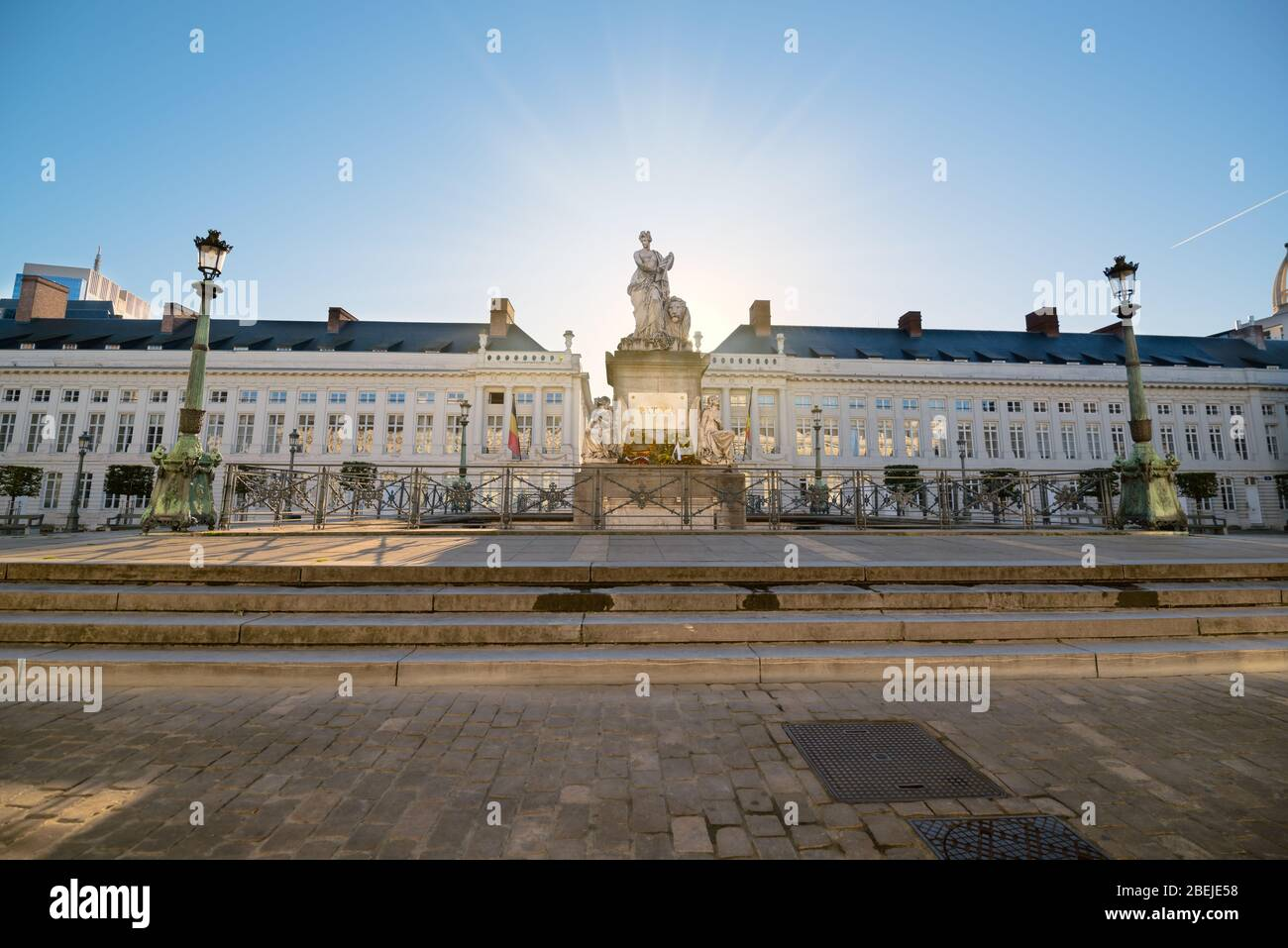 Martyrs' Square (Place des Martyrs). Sunrise behind statue. Belgian flag. Brussels, Belgium Stock Photo