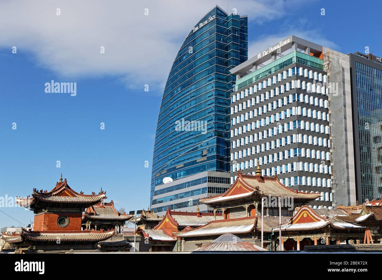 ULAANBAATAR, MONGOLIA, March 9, 2020 : Traditional monastery in the city center contrasts with huge modern buildings. Stock Photo