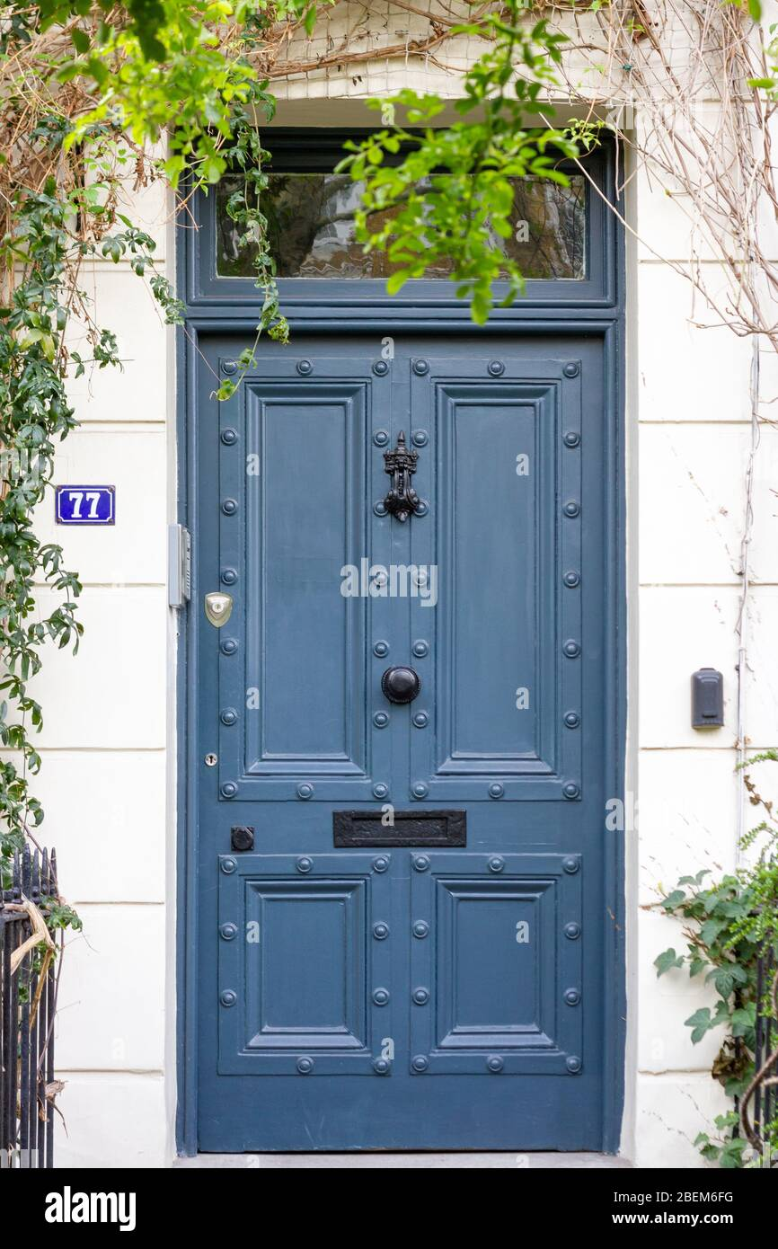 Elegant House Front Door With The Number 77 With Winding Hanging Plants Stock Photo Alamy