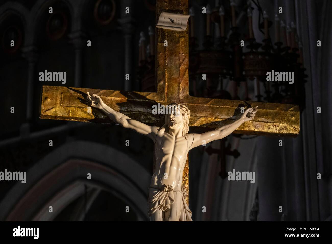 Close up of a sculpture of Jesus Christ on the cross at the Basilica of Our Lady of the Rosary in Lourdes, France, Europe Stock Photo