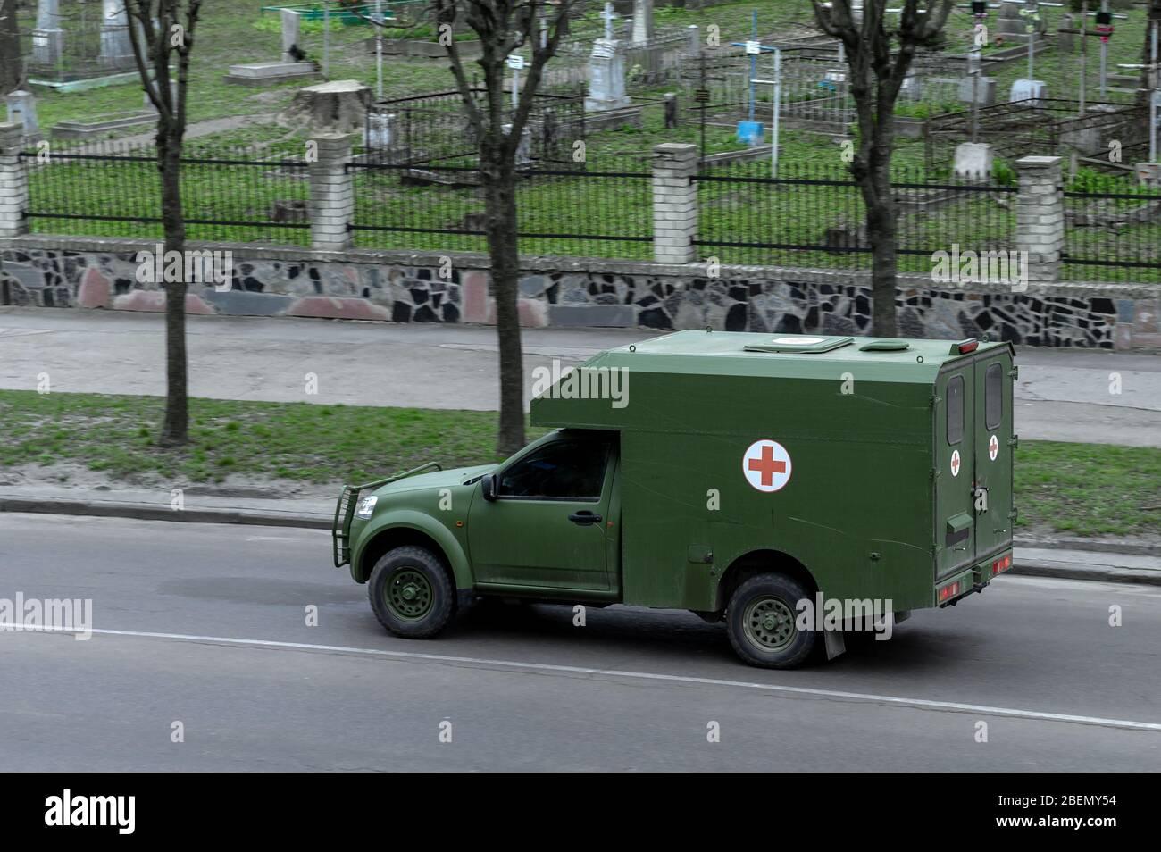 RIVNE, UKRAINE - APRIL 14, 2020. Mmilitary ambulance in the city Stock Photo