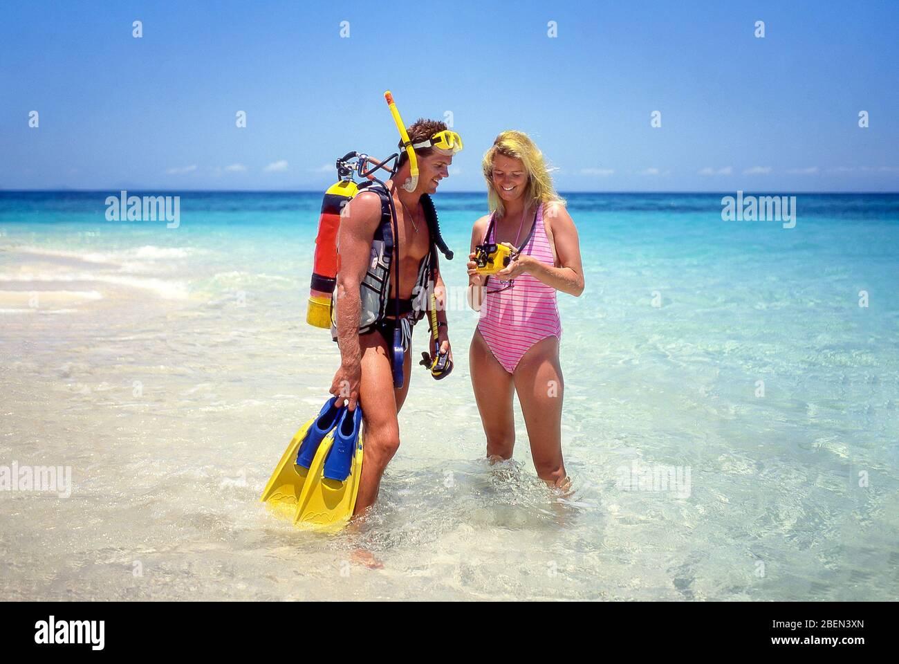 Couple scuba diving, Kuda Bandos, Kaafu Atoll, Republic of Maldives Stock Photo