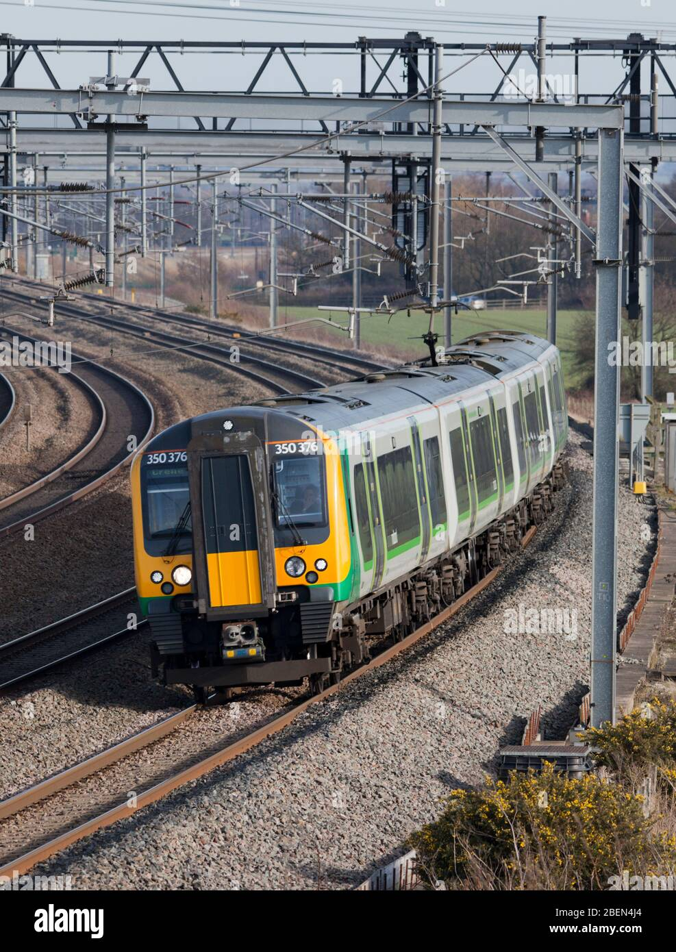 London Midland Siemens Desiro class 350 train on the 4 track west coast mainline in the Trent valley, UK with a local all stations stopping train Stock Photo