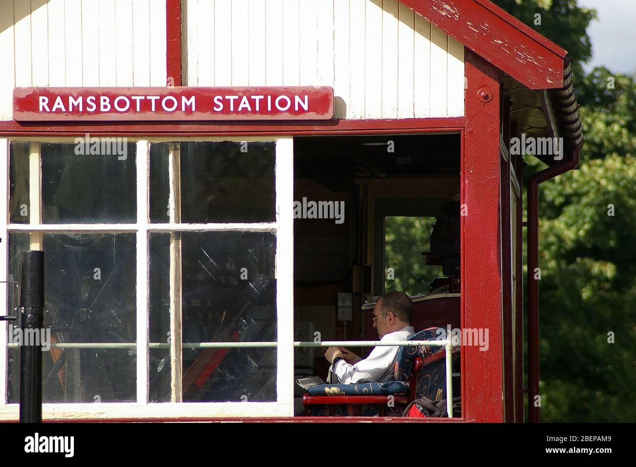 Ramsbottom, Lancashire, UK / August 24 2008: Railway signalman sitting in the signal box at Ramsbottom station on the historic East Lancashire Railway Stock Photo