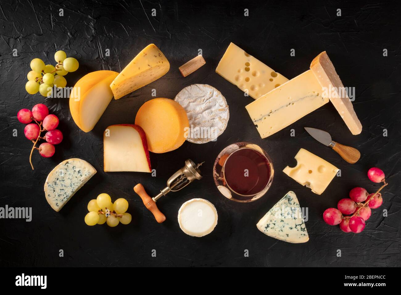 Cheese and wine, shot from the top on a black background Stock Photo