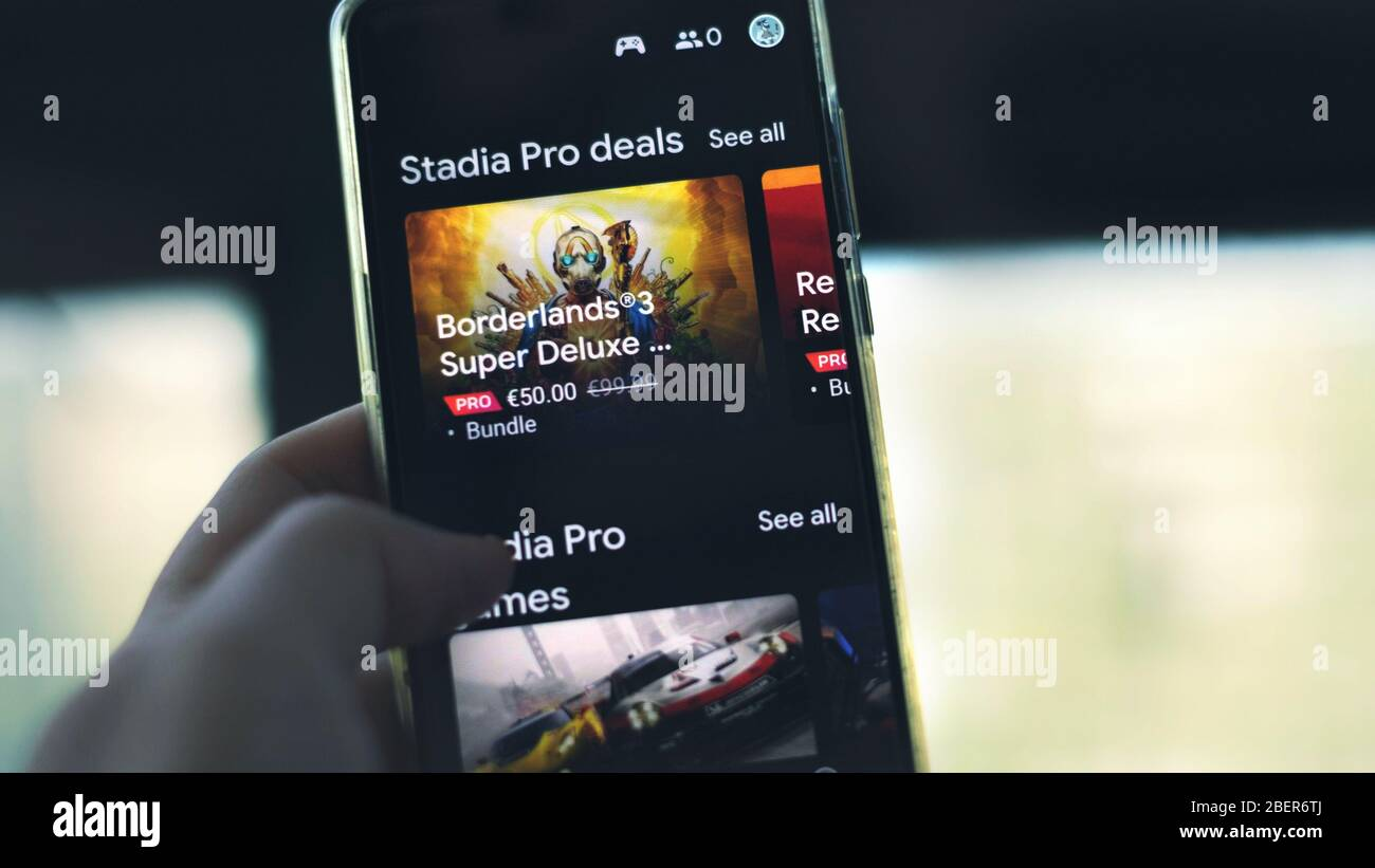 Google Stadia pro deals on app smartphone cloud gaming streaming service Stock Photo