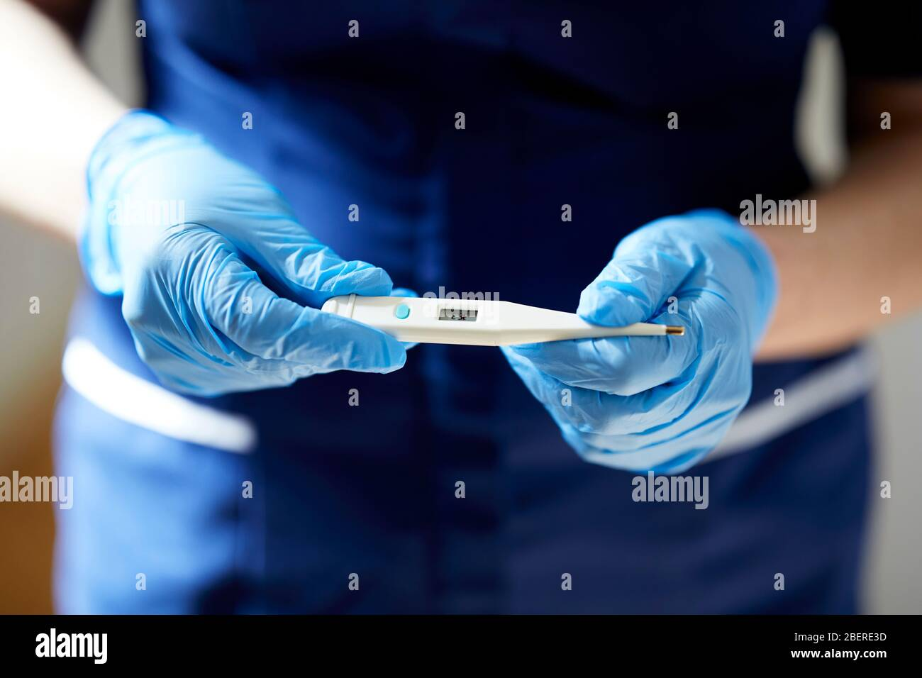 Nurse holding thermometer Stock Photo