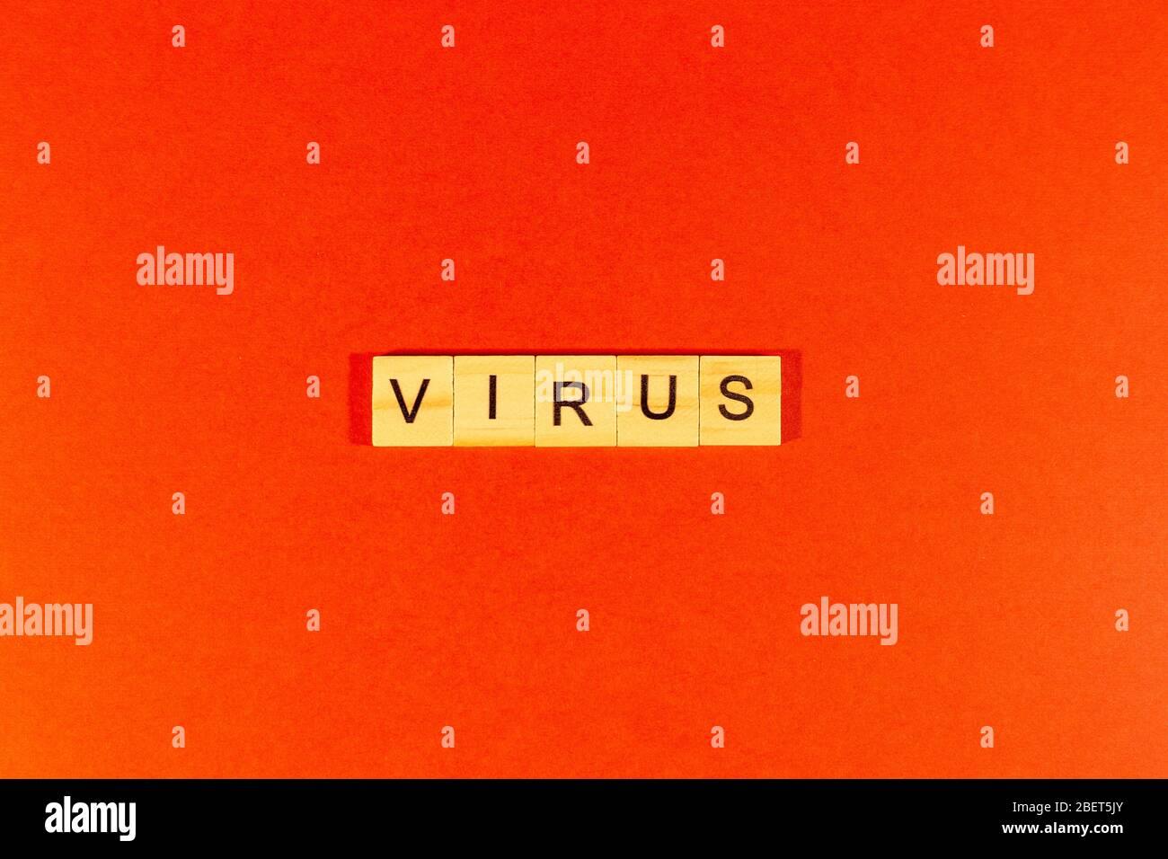 Virus the word is written on a red background. Novel coronavirus - 2019-nCoV, WUHAN virus concept. Chinese coronavirus outbreak. Red background Stock Photo