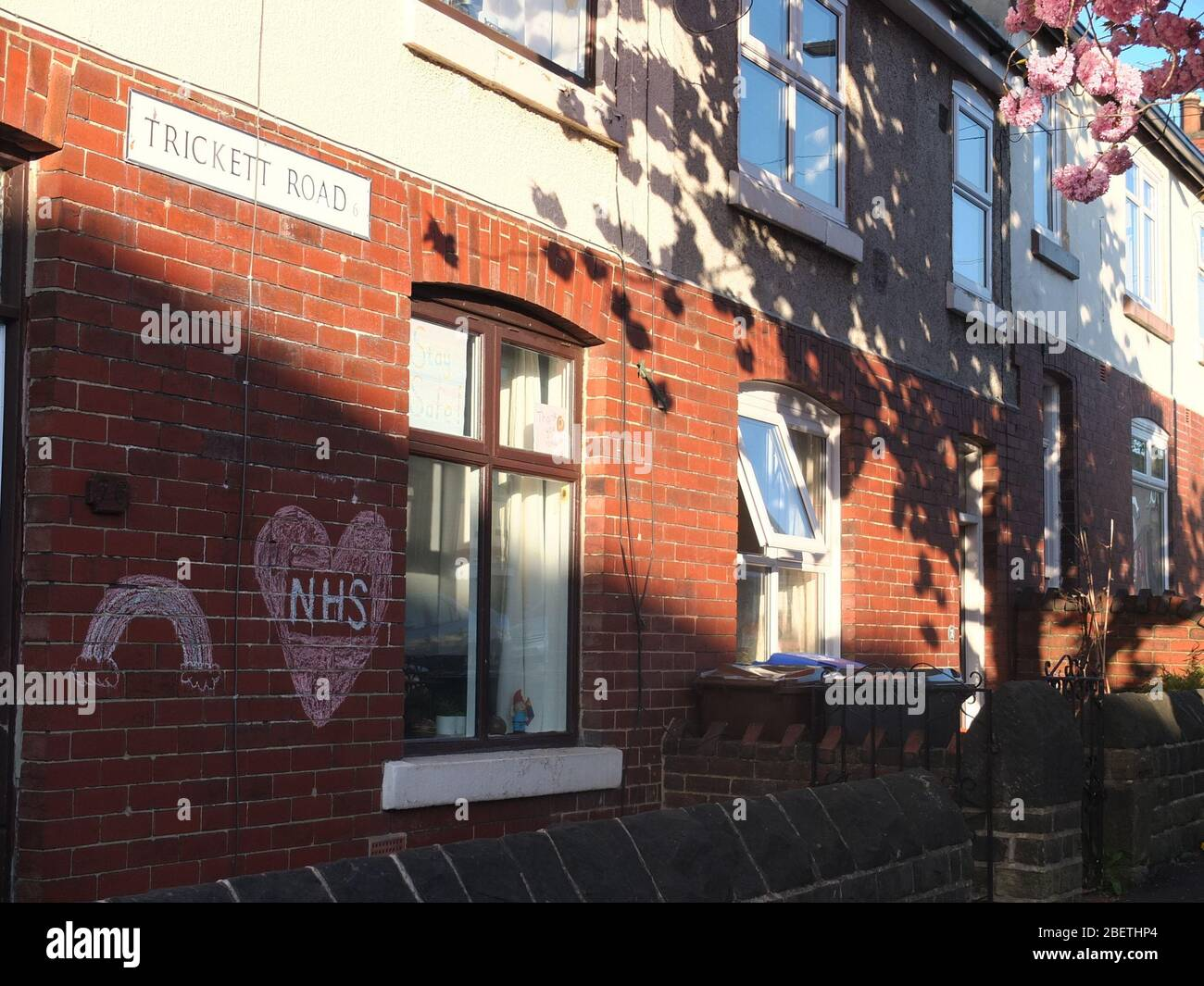 A message of support and gratitude to the NHS with a rainbow chalked on the wall of a house on Trickett Road, Sheffield during the Coronavirus crisis Stock Photo