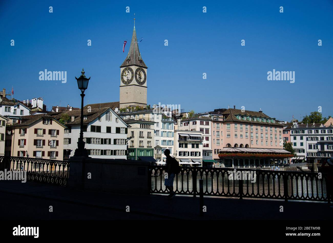 View of St. Peter evangelistic church from Munsterbrucke Bridge over the Limmat river in the historic city center of Zurich, Canton of Zurich, Switzer Stock Photo