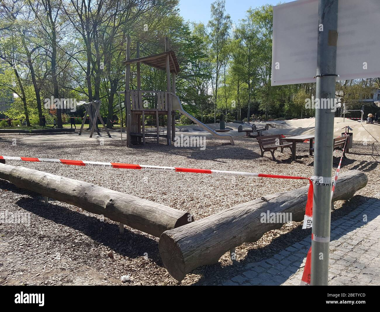 Empty Abandoned Children Playground Or Play Field In Park Forest With Slide Closed With Police Barrier Tape Warning Sign Corona Virus Covid 19 Stock Photo Alamy