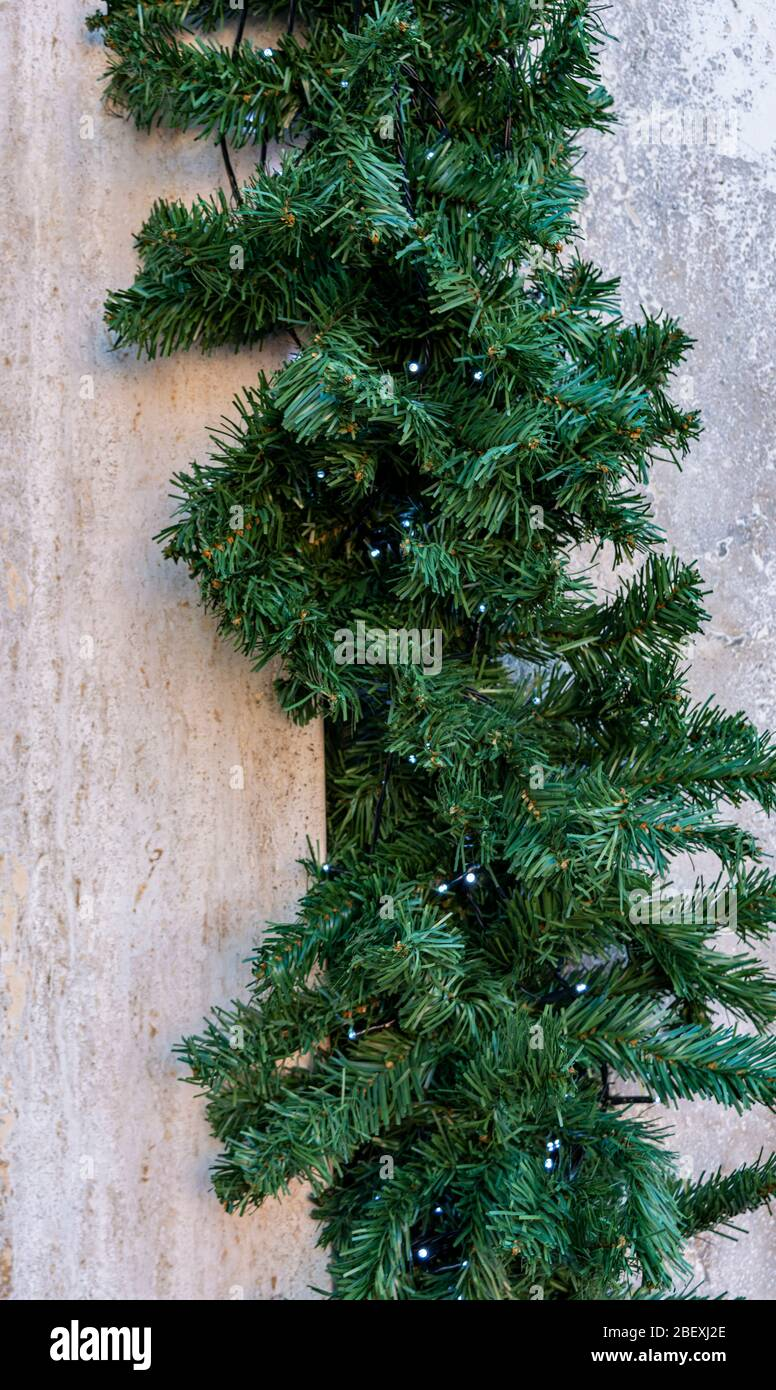 Christmas Decoration On The Wall Of An Apartment Building Christmas Tree Decorates The Corner Of The House Stock Photo Alamy