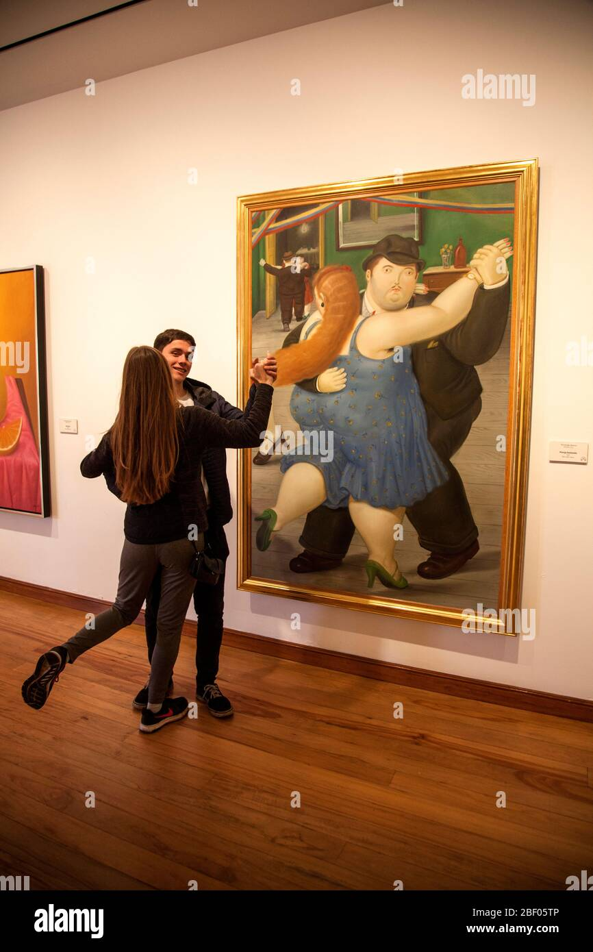 Couple imitating the Pareja bailando, Couple dancing, painting by Botero at the Botero Museum also known as Museo Botero, Bogotá, Colombia. Stock Photo