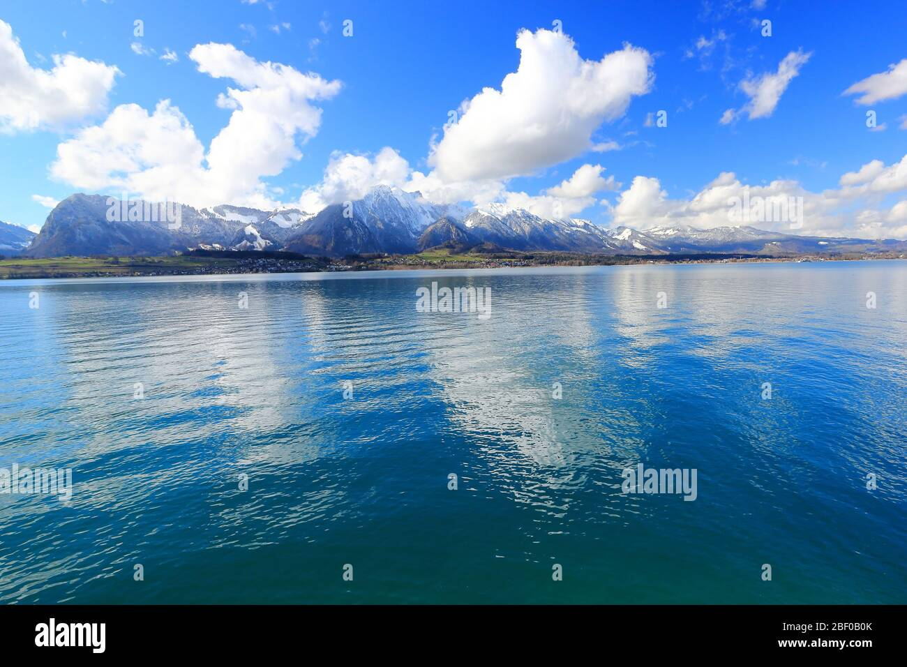 View of Bernese Alps from Oberhofen, located on the northern shore of Lake Thun. Switzerland, Europe. Stock Photo