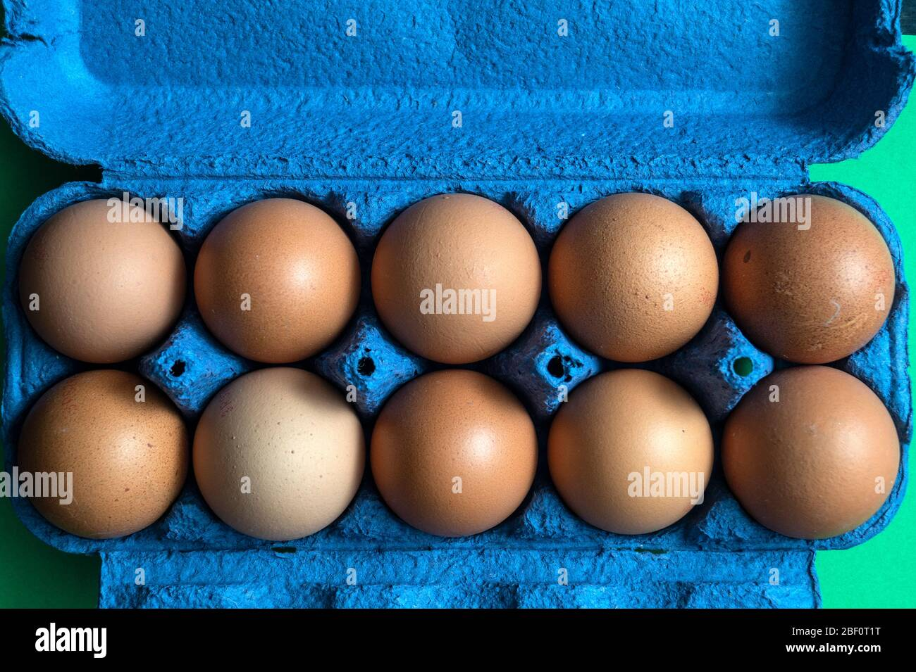 Organic brown chicken eggs in carton on rustic wooden table backgrounds, natural healthy food concepts Stock Photo