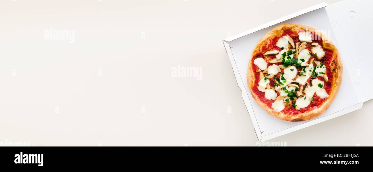 banner of pizza with mushrooms in a box for delivery, advertising or menu Stock Photo