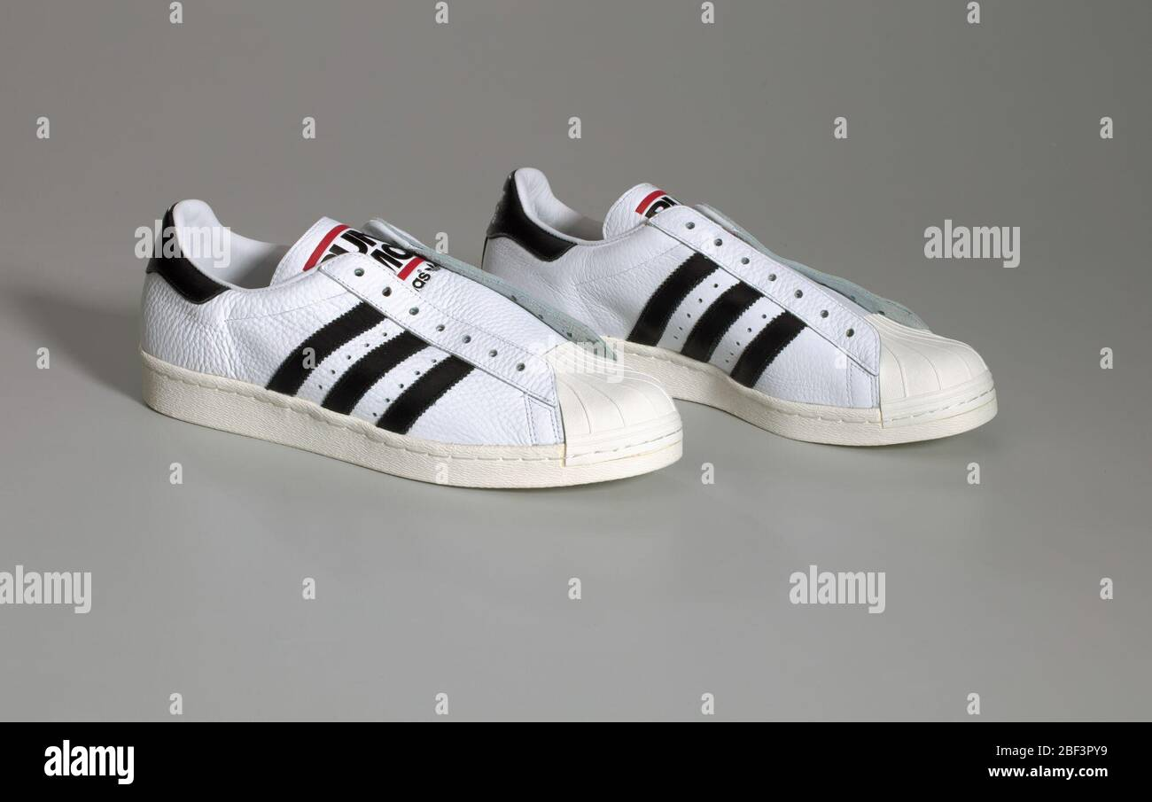 Pair of white and black RunDMC Superstar 80s sneakers made by ...
