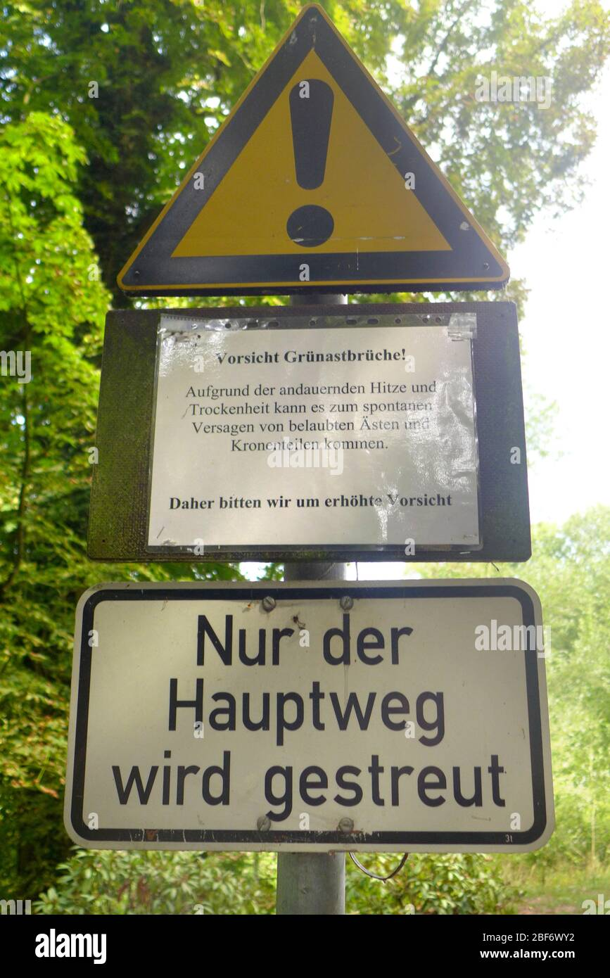 duty to implement safety precautions, warning sign against broken branches, Germany Stock Photo