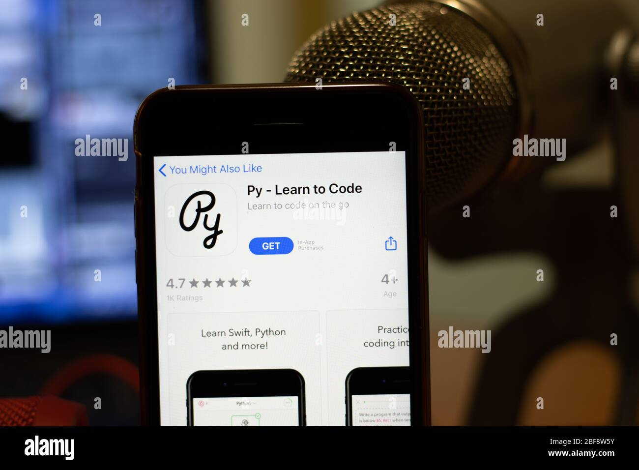 Los Angeles, California, USA - 16 April 2020: Py Learn to Code logo on screen close up. App store icon visible on phone display, Illustrative Stock Photo