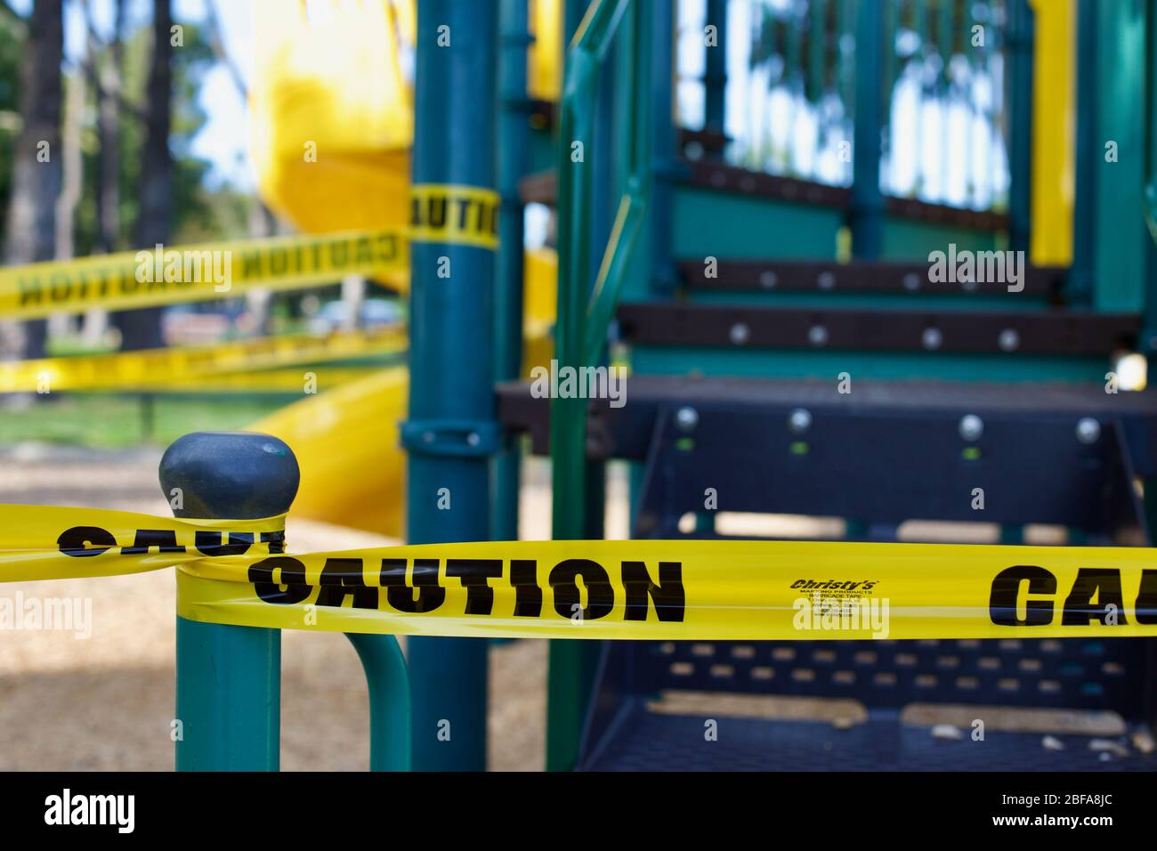 roped off playground with caution tape during COVID-19 and coronavirus Stock Photo