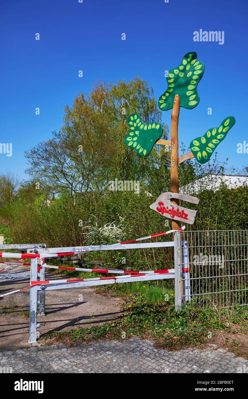 Children's playground in Berlin, Germany, which was closed due to the Covid-19 virus and the blocking of contact with a barrier tape. The text means p Stock Photo