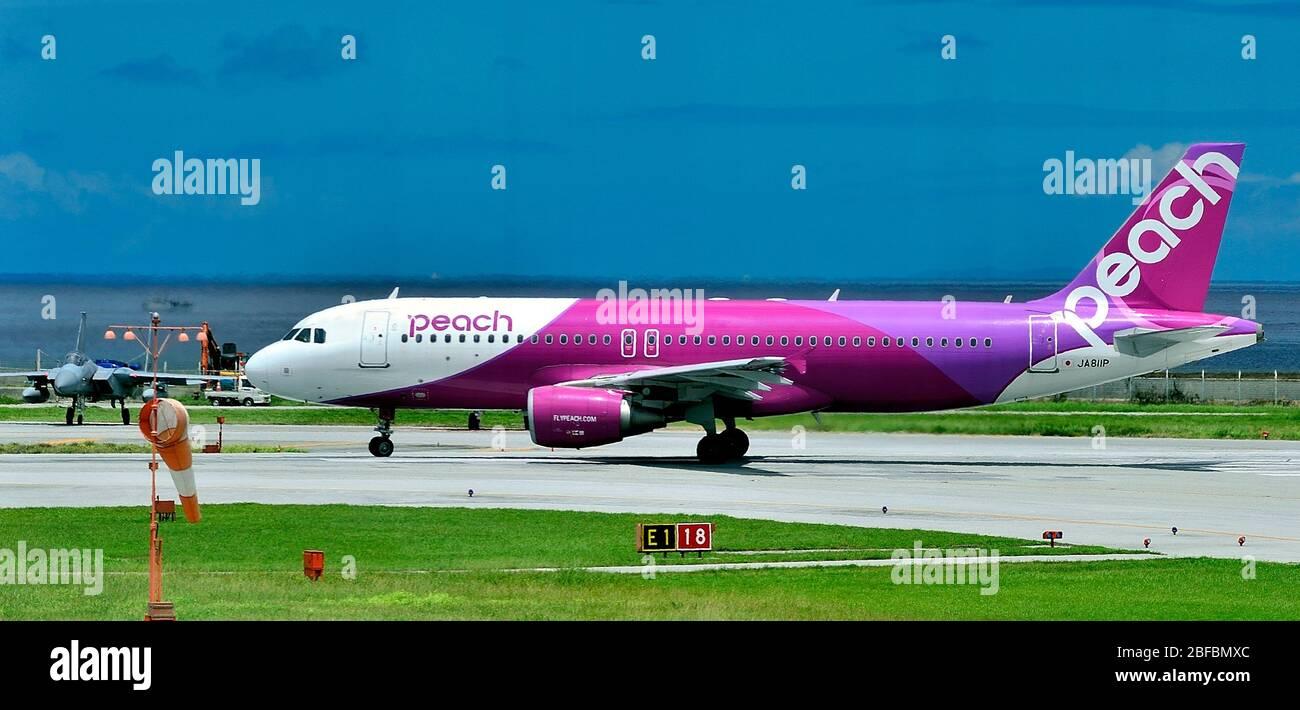 Peach, Airbus A320, JA811P, JAF F-15, Waiting, Naha Airport, Naha, Okinawa, Ryukyu Islands, Japan Stock Photo