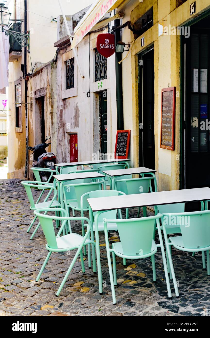 Mint Green Cafe Chairs And Tables Outside A Sidewalk Cafe In Lisbon Alfama Stock Photo Alamy