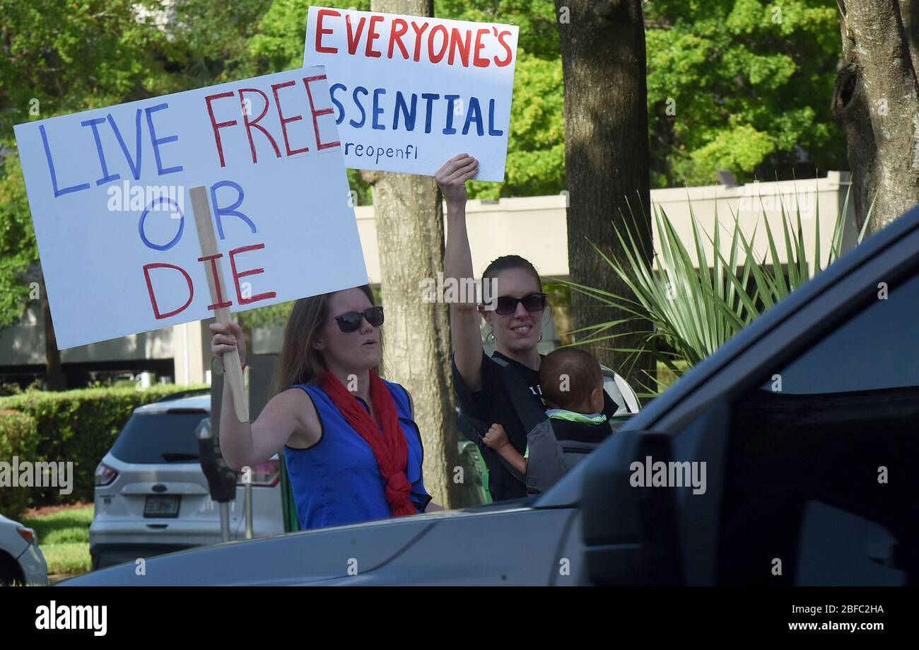 April 17, 2020 - Orlando, Florida, United States - Protesters demonstrate outside the Orange County Administration Building in Orlando, Florida on April 17, 2020 demanding the end of stay-at-home orders and the reopening of Florida businesses as the COVID-19 pandemic keeps thousands of people in their homes and out of work. (Paul Hennessy/Alamy) Credit: Paul Hennessy/Alamy Live News Stock Photo