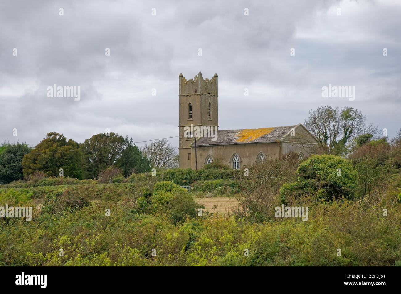 St Mary's church situated on Johns Hill above the estuary at Kieran's Quay in County Wexford on an overcast day in October. Stock Photo