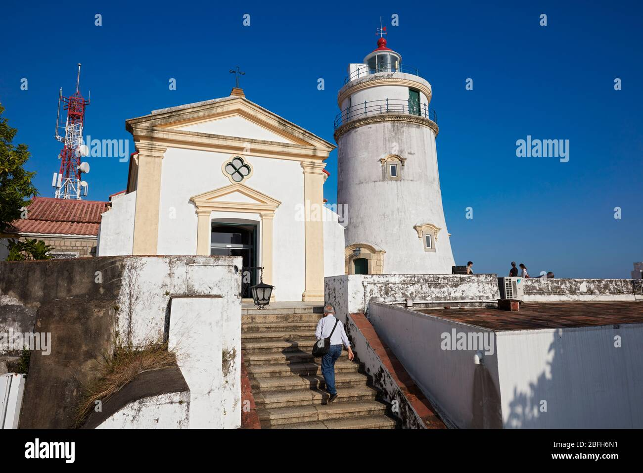 Man walking up the stair at the Guia Fortress, a 17th-century colonial military fort, chapel and lighthouse complex in Macau, China. Stock Photo