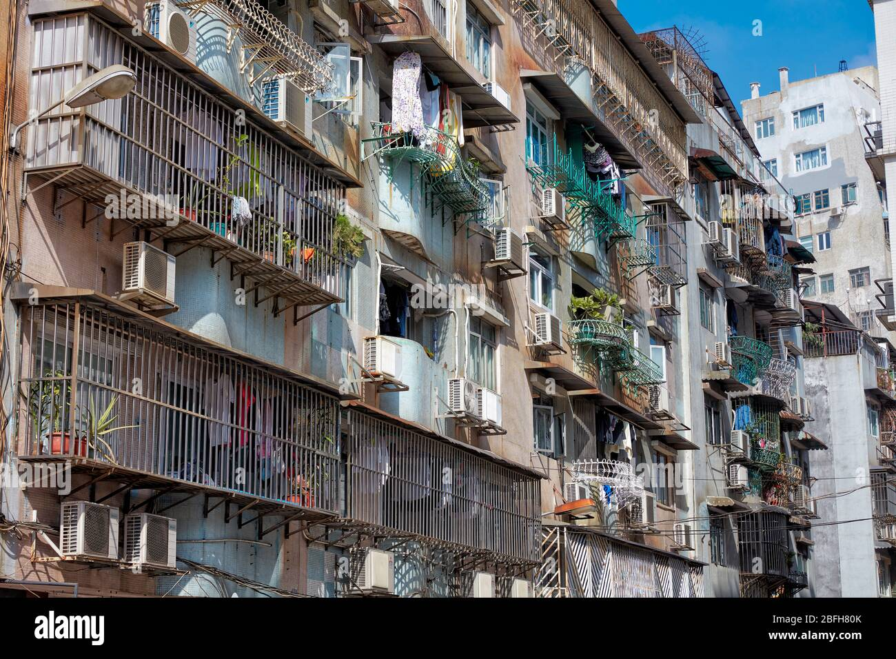 Facade of a multi-storey residential building with fenced balconies. Macau, China. Stock Photo