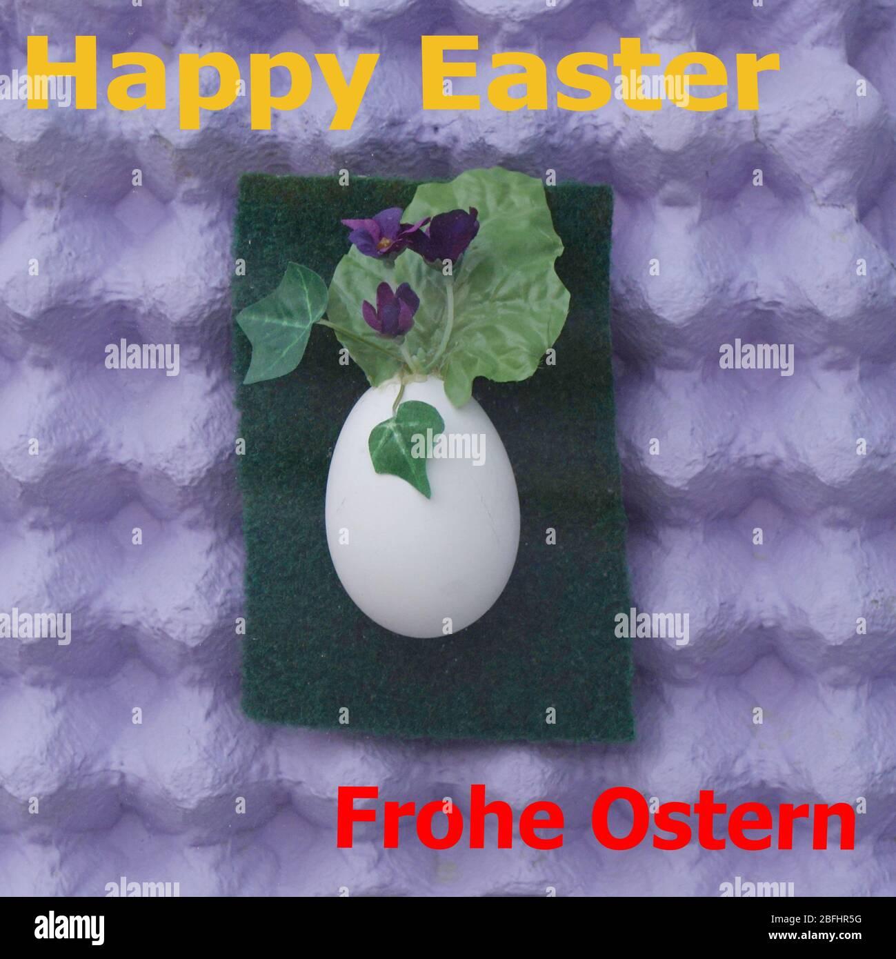 Deko Osterei mit Eierschachteln als Hintergrund Stock Photo