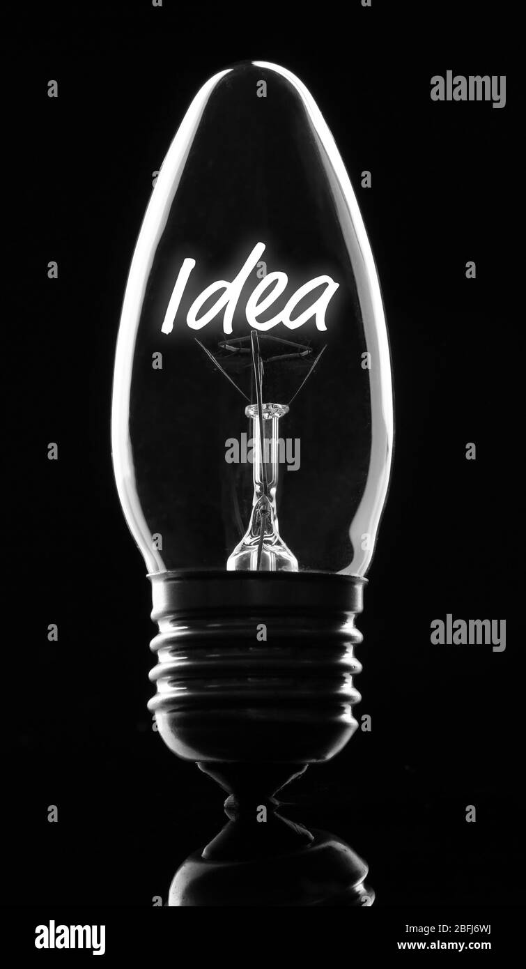 Light Bulb On Dark Background Stock Photo Alamy