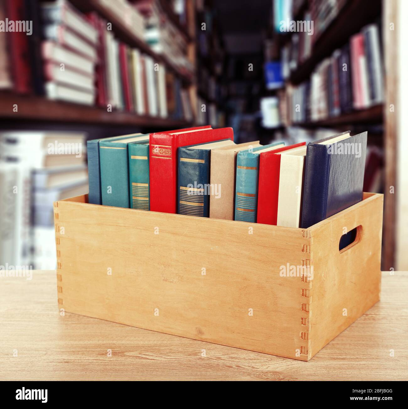 Books In Wooden Crate On Bookshelves Background Stock Photo Alamy
