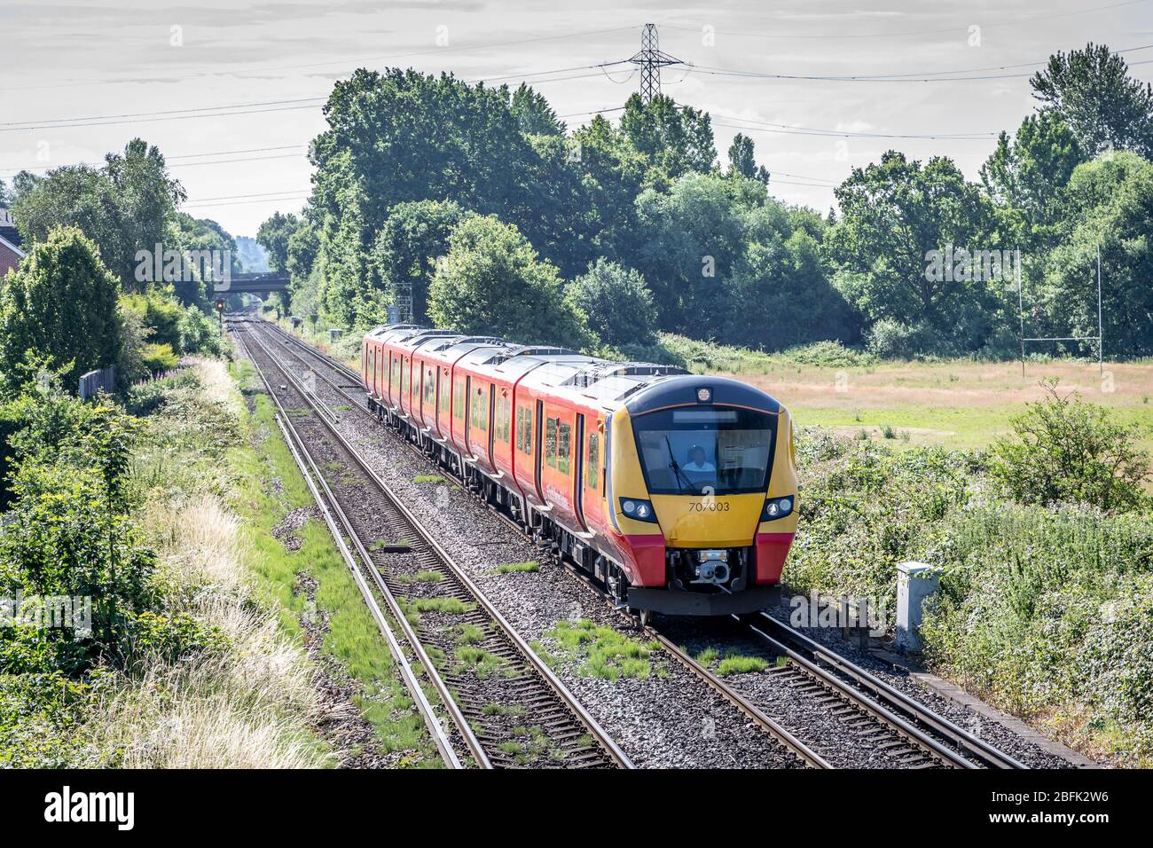 South West Tains Desiro City No. 707003 approaches Chertsey station, Surrey, England, UK Stock Photo