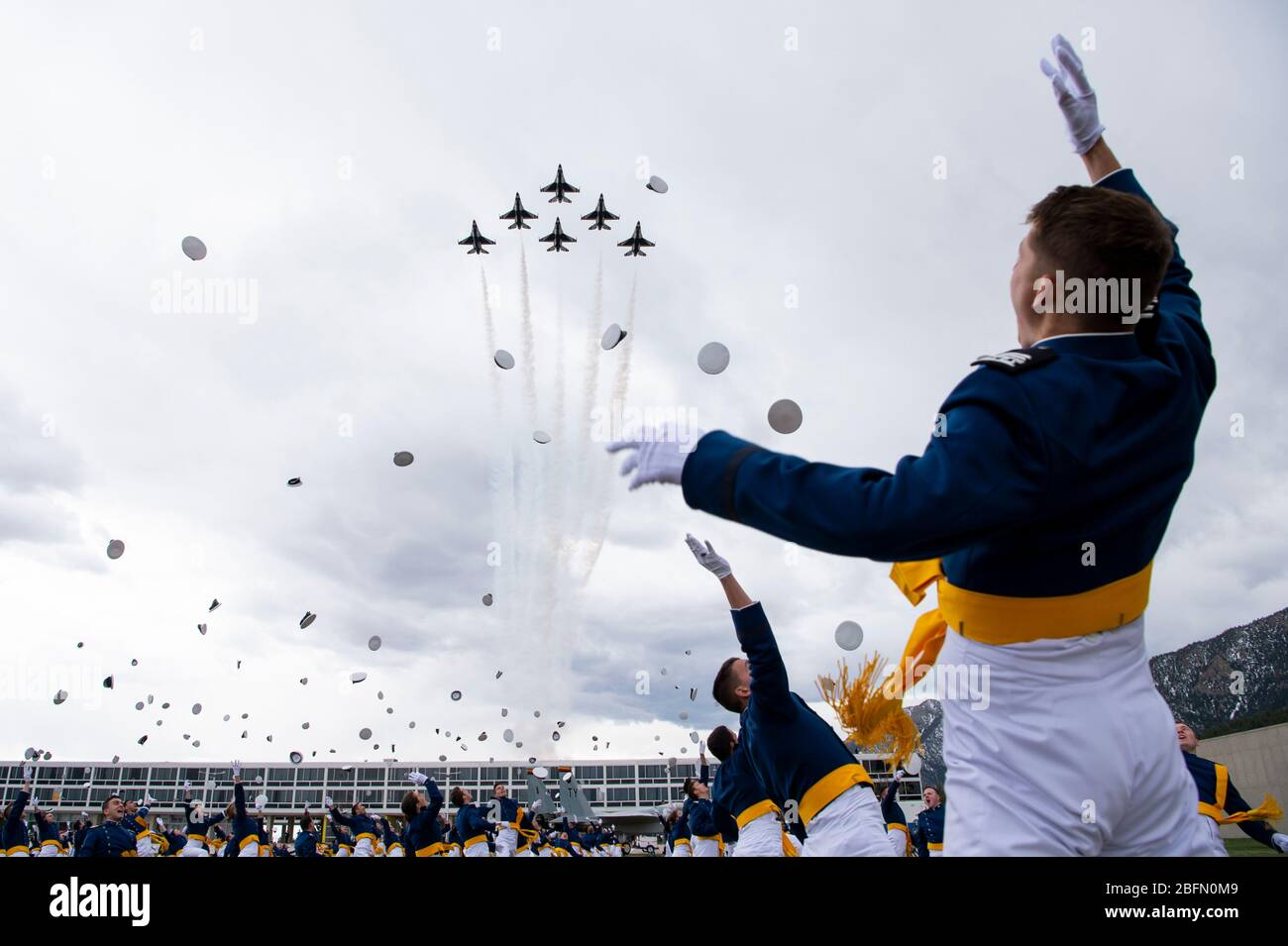 Colorado Springs, United States. 18th Apr, 2020. U.S. Air Force Cadets toss their caps into the air Air Force as the Thunderbirds roar overhead to celebrate graduation for the class of 2020 at the Air Force Academy April 18, 2020 in Colorado Springs, Colorado. Cadets were required to remain 8-feet due to the COVID-19, coronavirus pandemic. Credit: Joshua Armstrong/US Air Force/Alamy Live News Stock Photo