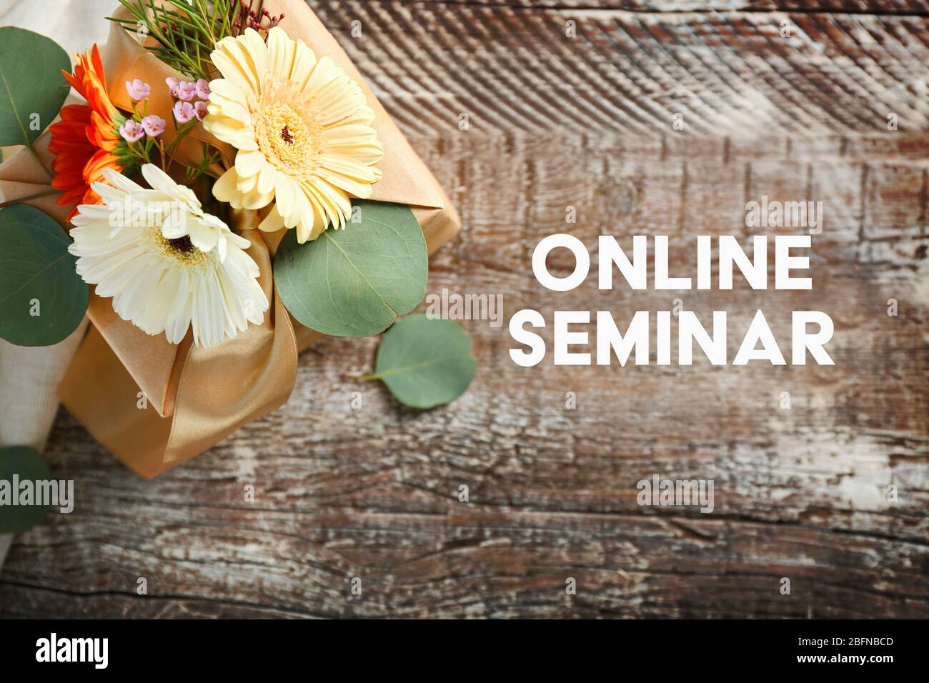 Gift Box Decorated With Flowers And Text Online Seminar On Wooden Background Florist And Floral Design Tutorial Concept Stock Photo Alamy