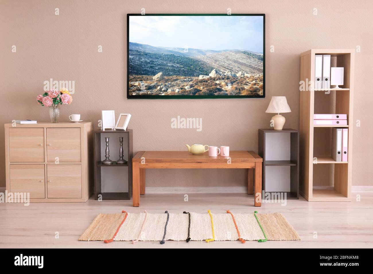 Cozy Interior Of Living Room With Tv On Wall Stock Photo Alamy