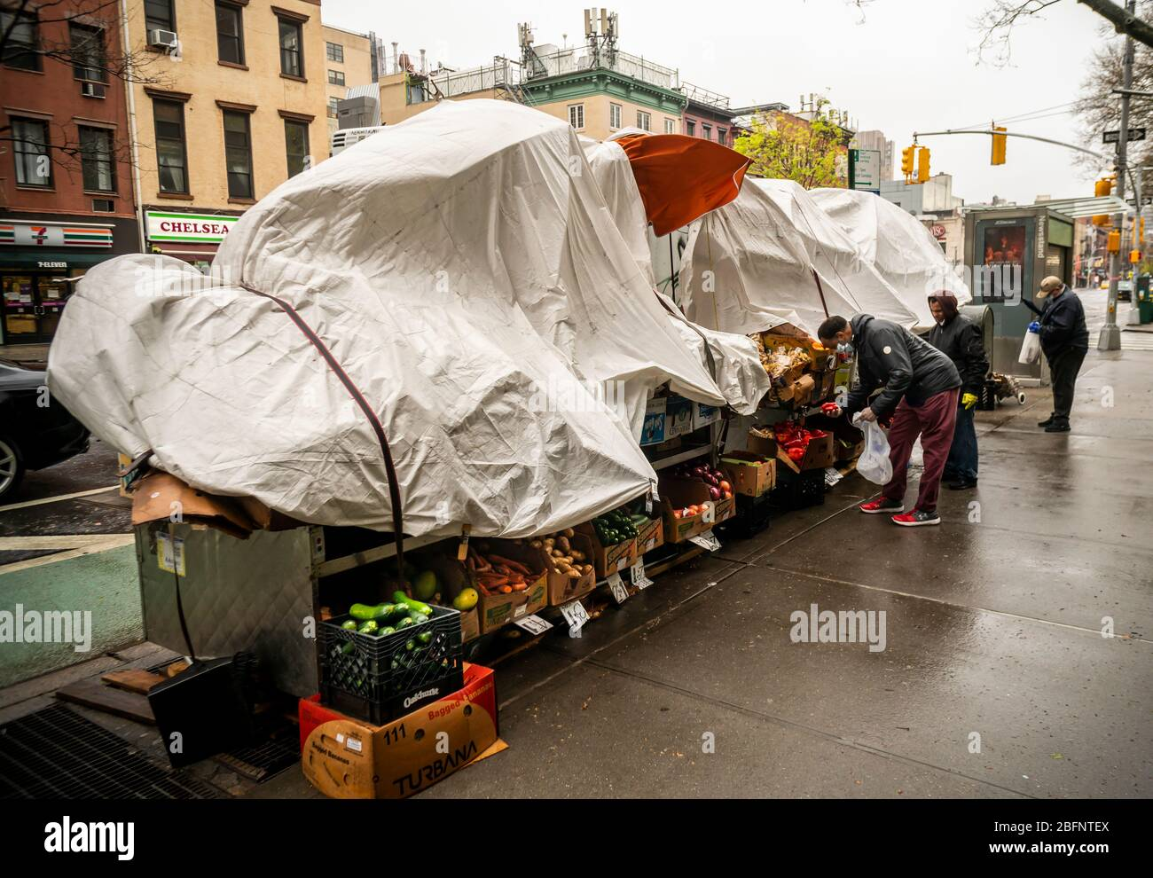 A fruit stand in the Chelsea neighborhood of New York on Monday, April 13, 2020 prepares for the windy weather. Winds in the afternoon are expected to gust from 60-70 mph. (© Richard B. Levine) Stock Photo