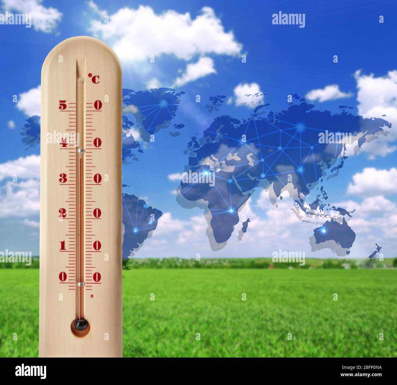 World map with thermometer showing high temperature and landscape on background. Concept of global warming and climate change. Save planet and environ Stock Photo