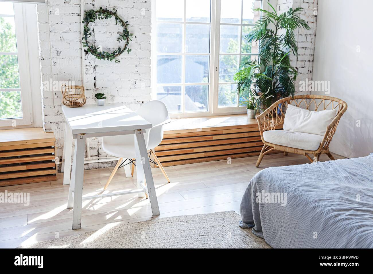 Stylish Loft Modern Home Office Interior Spacious Design Apartment With Light Walls Large Windows And Writing Desk Clean Modern Decoration With Elegant Furniture In Minimalist Scandinavian Style Stock Photo Alamy