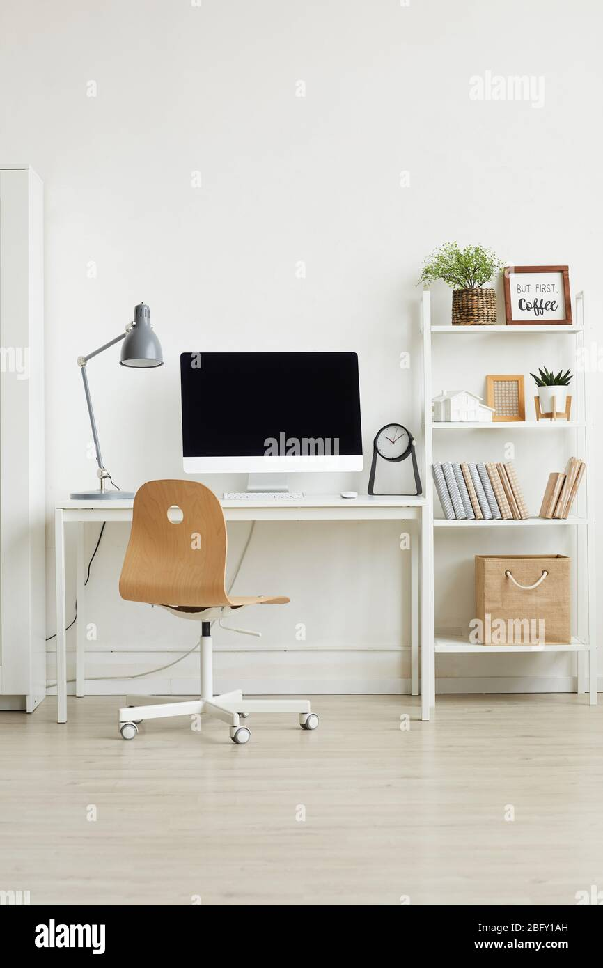 Background Vertical Background Image Of Minimal Home Office Interior With Wooden Chair And White Computer Desk Against White Wall Copy Space Stock Photo Alamy