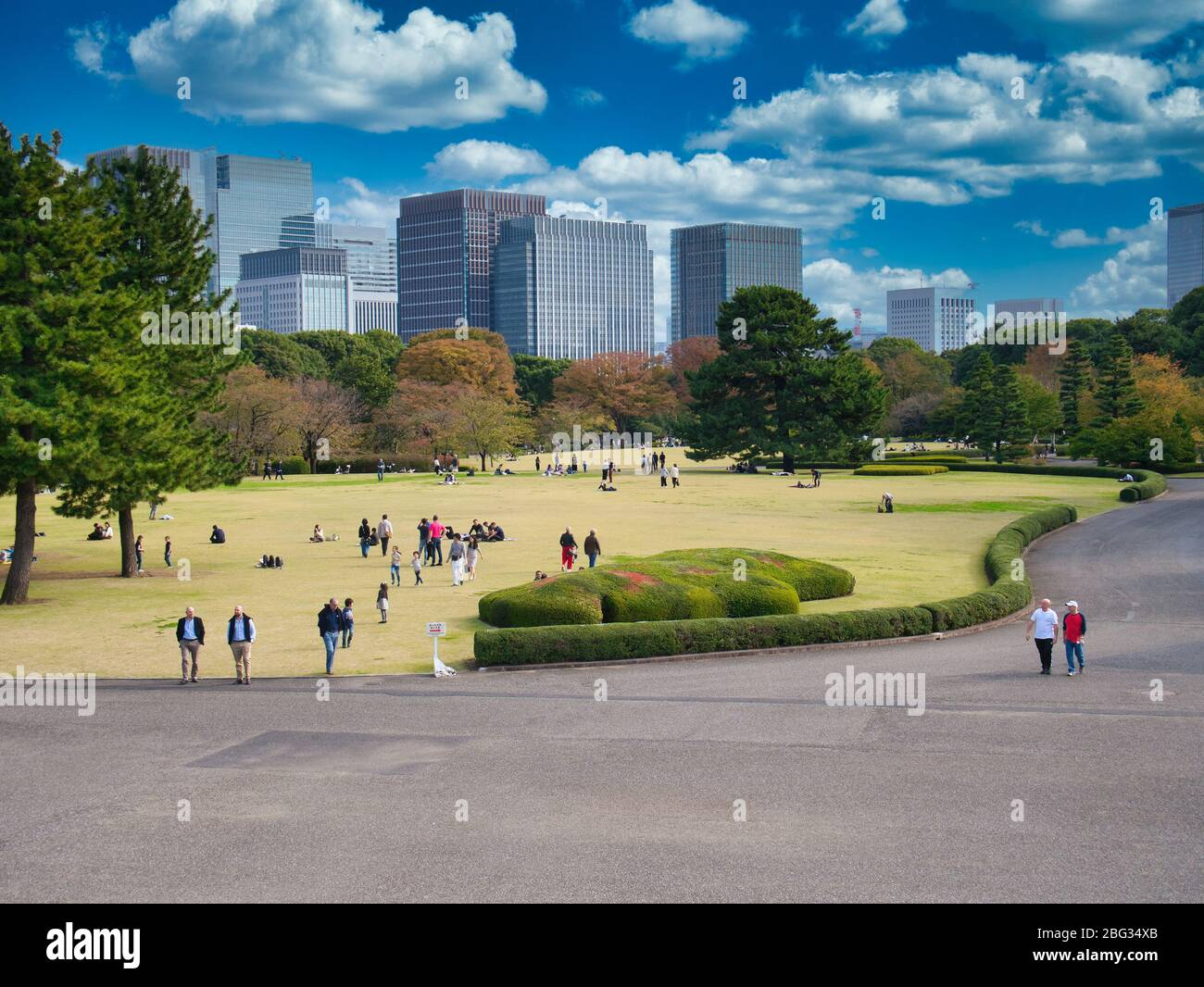 With a backdrop of city skyscrapers, a view the Imperial Palace East Gardens in Tokyo Stock Photo