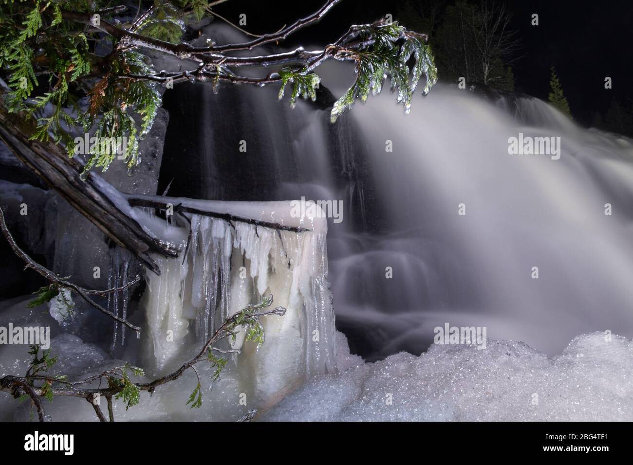 A frozen waterfall in kitch-iti-kipi state park in Michigan Stock Photo