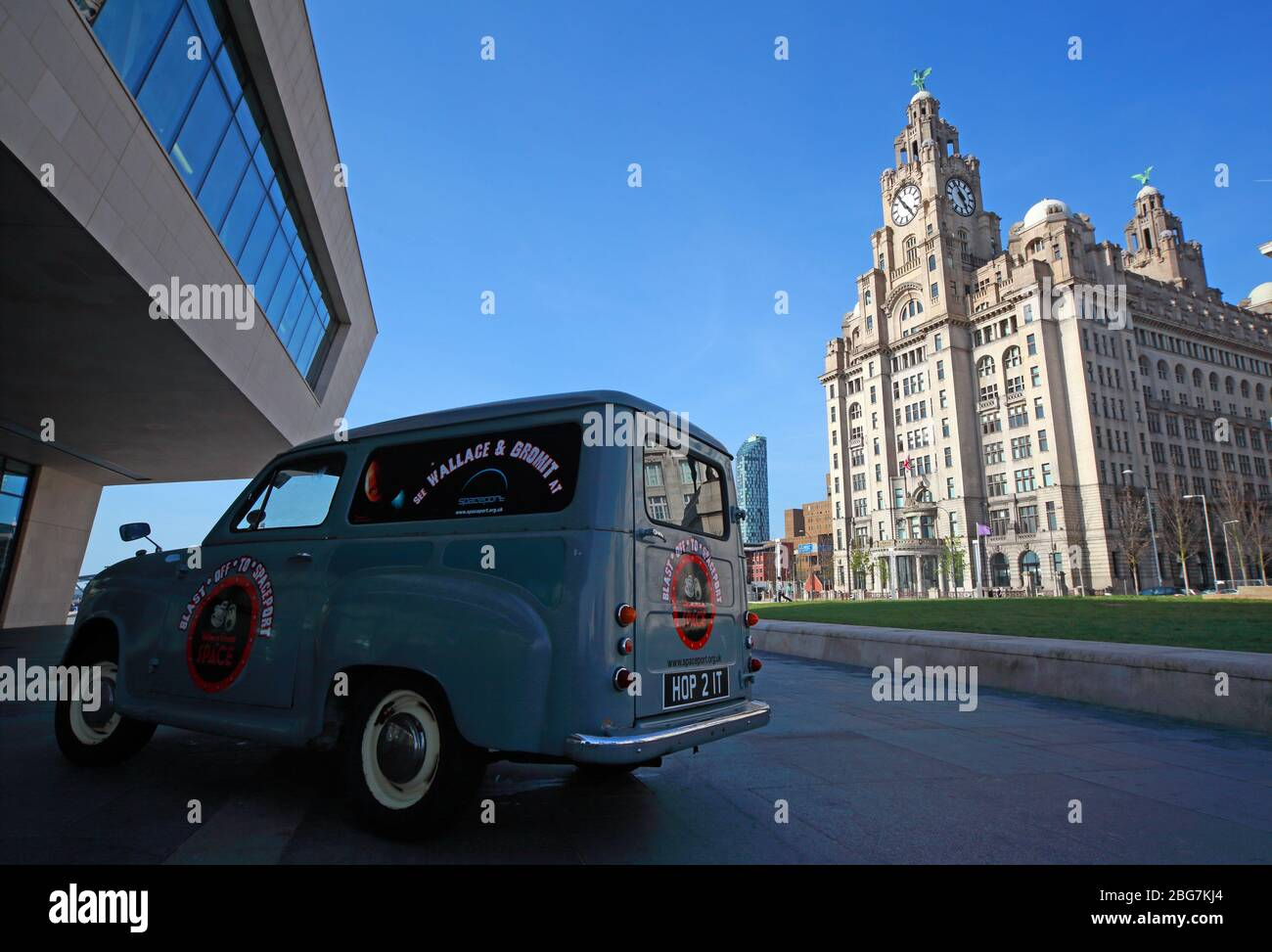 Wallace and Grommet Austin A35 blue van,HOP 2IT, at Pier Head waterfront,Royal Liver Building,Three Graces, Liverpool city centre, Merseyside Stock Photo
