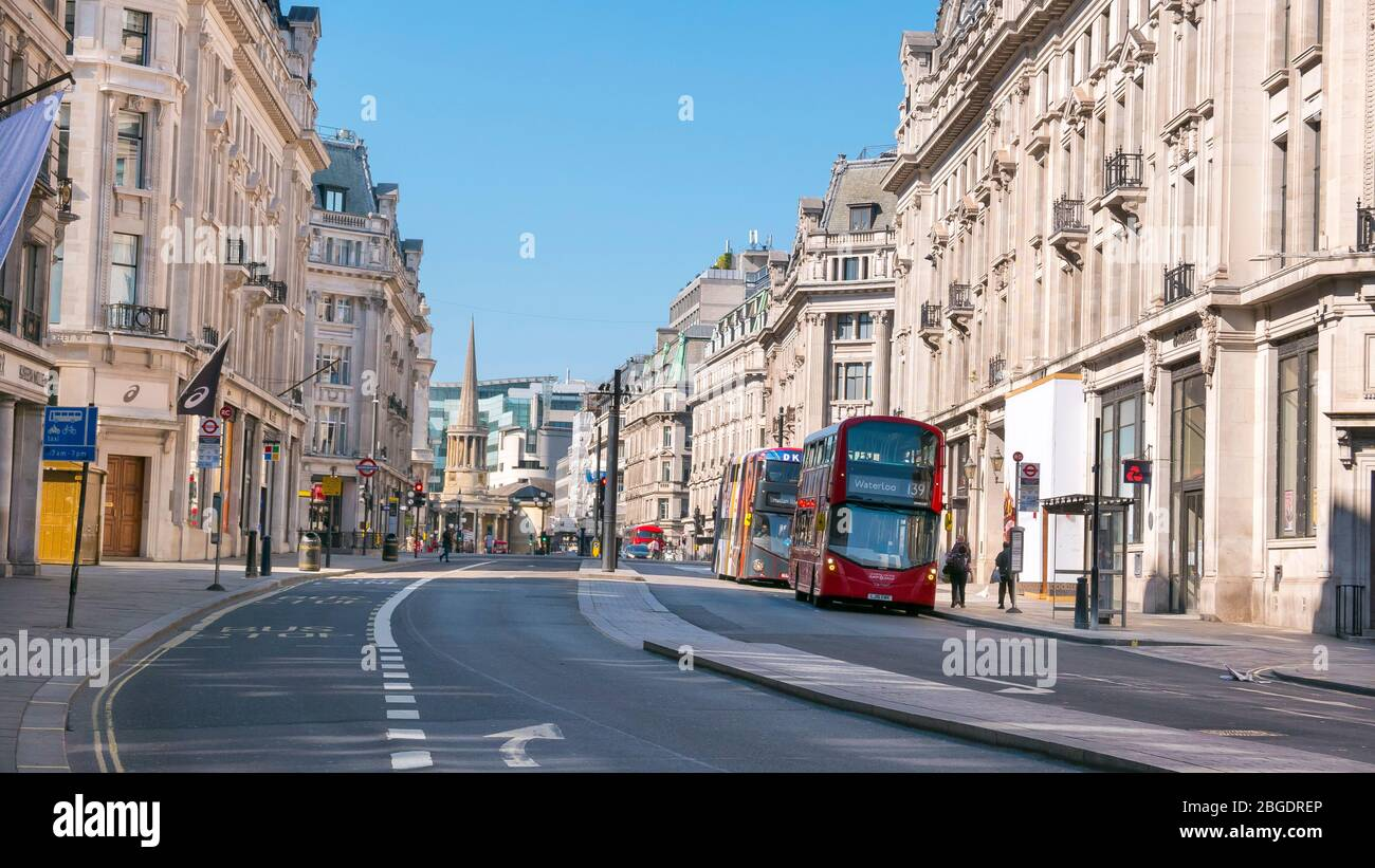 Coronavirus Pandemic a view  of Regent Street in London  April 2020. No people only a few buses  in the streets, all shops closed for Lockdown. Stock Photo